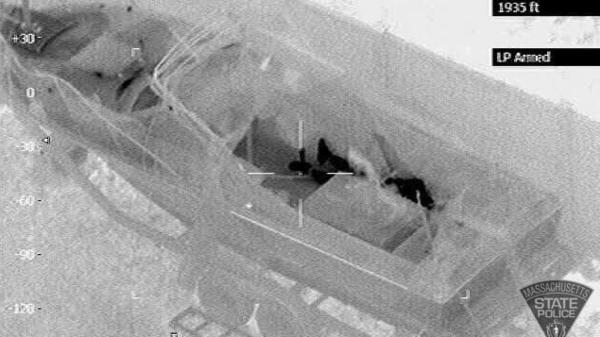 An infrared photograph taken from a police helicopter shows bombing suspect Dzhokhar Tsarnaev in the boat's cockpit area Friday night.
