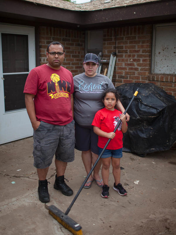 Eli and Maria Sanchez with their daughter, Kaylee, 6 at their home in Moore, Okla., on Friday.