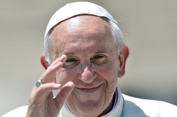 Pope Francis leaves after his weekly general audience in St Peter's square at the Vatican on June 12, 2013.