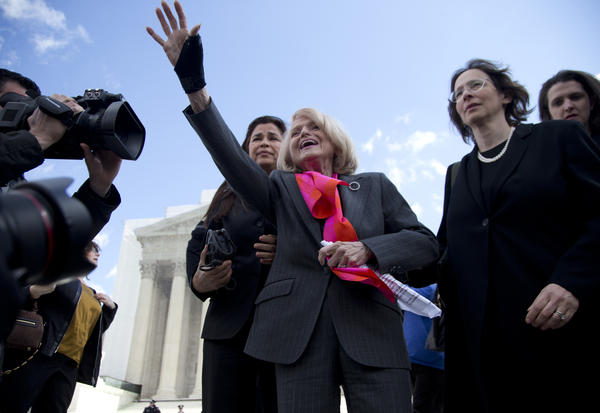 Plaintiff Edith Windsor of New York waves to supporters in front of the Supreme Court in Washington after the court heard arguments on her Defense of Marriage Act case.