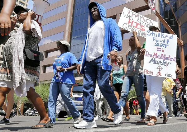 Marchers aligned with the Justice for Trayvon Martin movement called for a federal civil rights action to be filed against George Zimmerman in Phoenix on Monday. Zimmerman was found not guilty in the shooting death of Trayvon Martin.