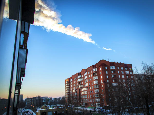 A meteor trail is seen above a residential apartment block in the Urals city of Chelyabinsk on Feb. 15.
