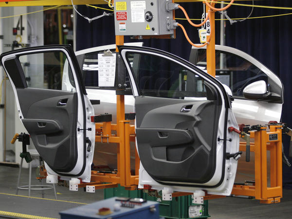 Doors for a Chevy Sonic hang on the assembly line at General Motors' Orion Assembly Plant in Lake Orion, Michigan, in 2011.