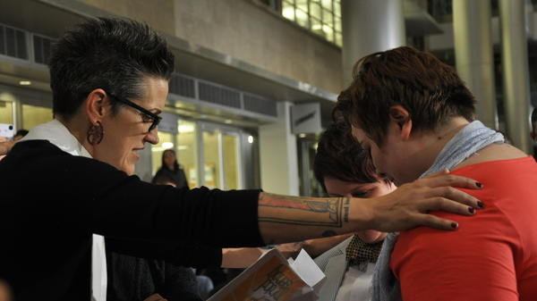 Pastor Nadia Bolz-Weber, shown here officiating civil union ceremonies in Denver in May, wrote a book on faith that recently landed on the <em></em><em>New York Times </em>best-seller list.