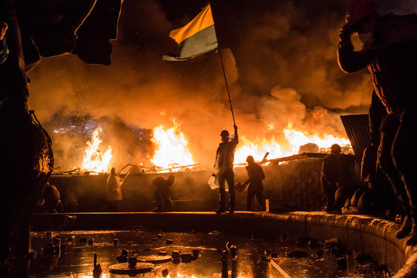 Anti-government protesters guard the perimeter of Independence Square, known as Maidan, on Tuesday in Kiev, Ukraine. Police in Ukraine's capital attacked an opposition camp that's been the center of the massive anti-government protests that began last November.