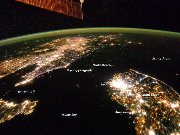 The same image of North Korea and its neighbors at night, with reference points added.