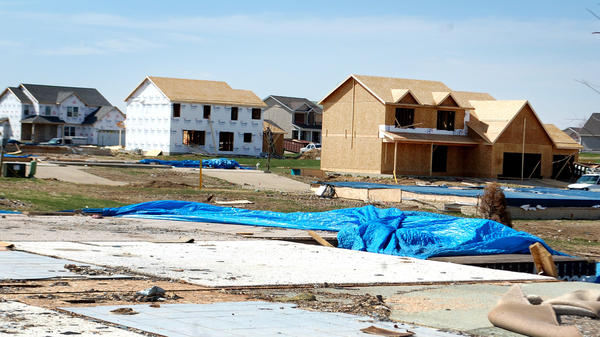 Building permits have been pulled to replace nearly half the wrecked homes in Washington.