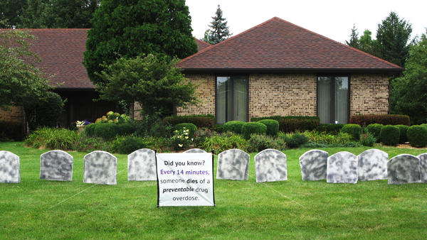 Faux tombstones line a lawn in Medinah, Ill. It's a campaign to heighten awareness about an epidemic of heroin and pain pill overdoses — a prelude to  International Overdose Awareness Day on Aug. 31.
