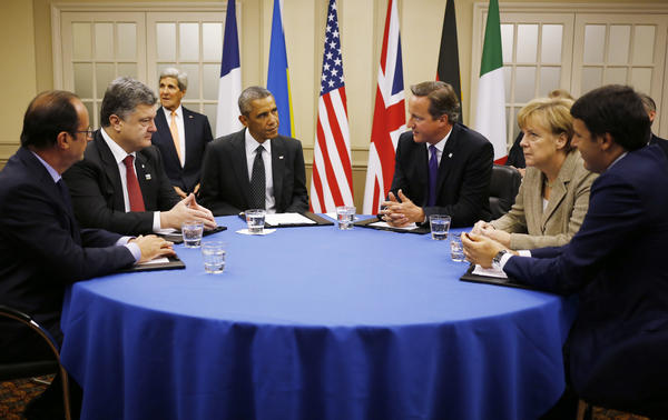 President Obama sits with (from left) French President Francois Hollande; Ukrainian President Petro Poroshenko; British Prime Minister David Cameron; German Chancellor Angela Merkel; and Italian Prime Minister Matteo Renzi as they meet about Ukraine Thursday at the NATO summit at Celtic Manor in Newport, Wales.