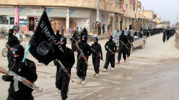 Islamic State fighters march in Raqqa, Syria. The group has killed five Western hostages in recent months. In the 1990s, many radical Islamist groups gave interviews to journalists and refrained from kidnapping Westerners.