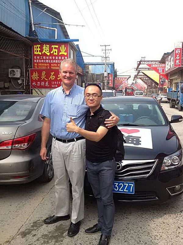 "NPR reporter Frank Langfitt and one of his ""customers,"" a biotech worker, whom he drove to a self-help conference in Shanghai's sprawling Pudong District."