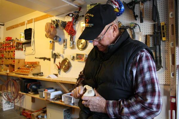 Vietnam veteran Gary Gratton carves an eagle head.