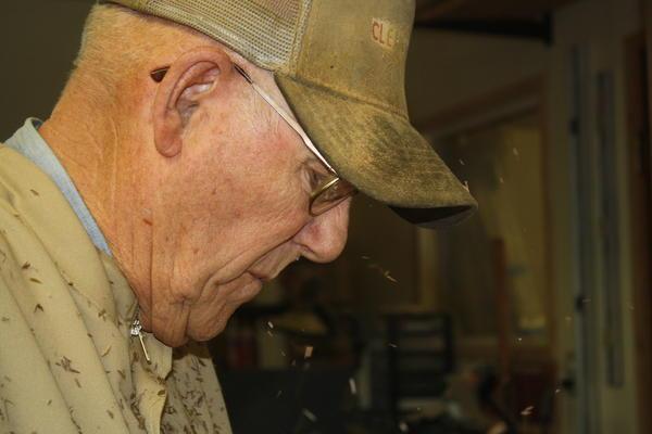Army veteran Bob Hampton makes a cane shaft.