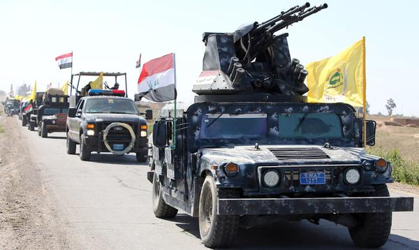 Members of Iraqi security forces drive toward an area south of Tikrit, Iraq, over the weekend. An Iraqi force has launched a military offensive, hoping to push ISIS out of Tikrit.