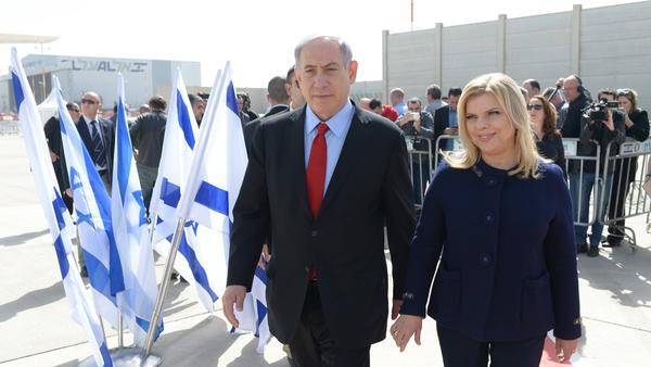 A handout image provided by the Israeli Government Press Office shows Prime Minister Benjamin Netanyahu and his wife, Sarah, leaving Tel Aviv on their way to Washington Sunday.