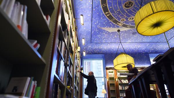 Fans are celebrating World Book Day on Thursday. Here, a man browses through books at the Albertine, a French bookstore and library at the French Embassy in New York.
