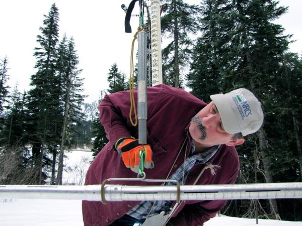 "<p>Scott Pattee, a water supply specialist with the National Resources Conservation Service, checks snow levels at Stevens Pass ski resort in Washington's Cascade Mountains. <span style=""color: #000000; font-family: Arial; font-size: 15px; white-space: pre-wrap; line-height: 1.7em; background-color: transparent;""><br /></span></p>"