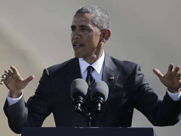"President Obama speaks near the Edmund Pettus Bridge in Selma, Ala., on Saturday, to mark the 50th anniversary of the ""Bloody Sunday"" civil rights march."
