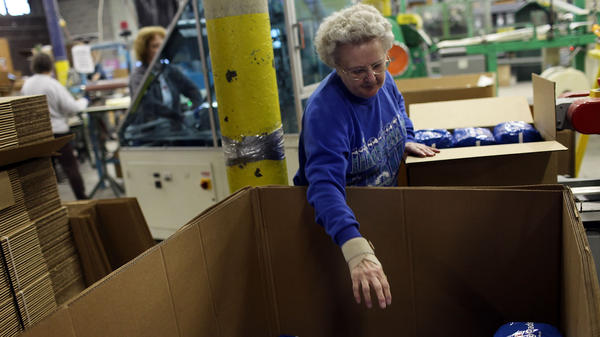 An employee at the American Disposables Inc. factory works on the assembly line in October 2009 in Ware, Mass. The state has seen rapidly expanding income disparity in the past 50 years as highly educated tech and financial workers have seen big gains and inflation-adjusted income has shrunk for the poorest residents.