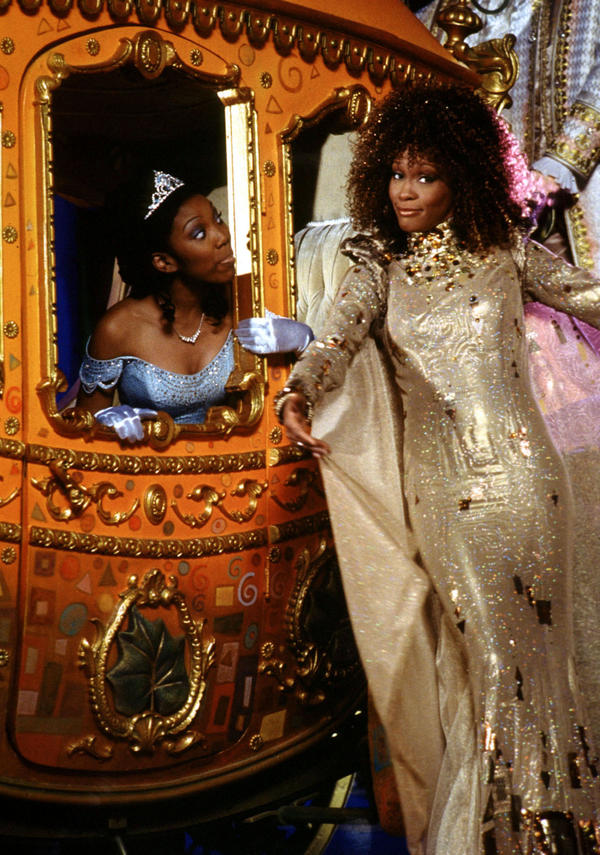Brandy Norwood and Whitney Houston pose with the coach from their version of <em>Cinderella</em>.