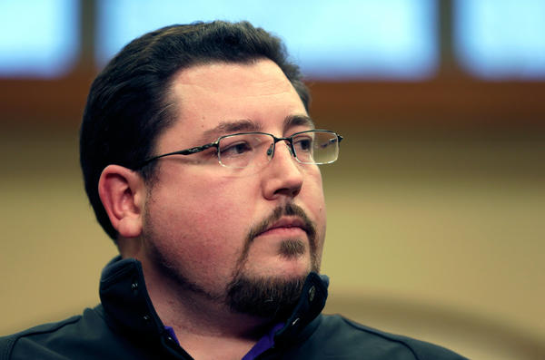 Ferguson Mayor James Knowles announces the resignation of police Chief Thomas Jackson during a news conference on Wednesday in Ferguson, Mo.