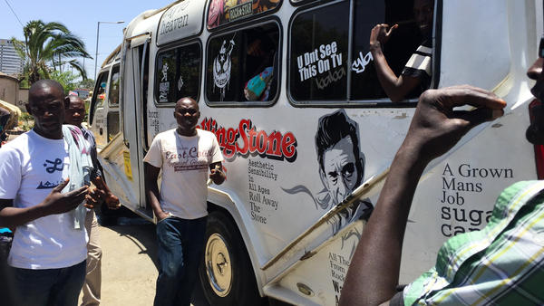 A minibus decorated with the logo of the Rolling Stone gathers no moss, but attracts plenty of riders.