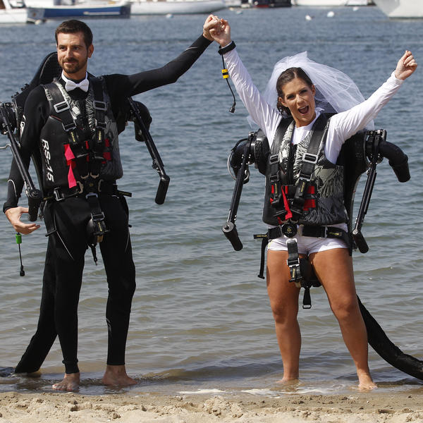 Grant and Amanda Engler celebrate in jet packs at their wedding ceremony in 2012 in Newport Beach, Calif.