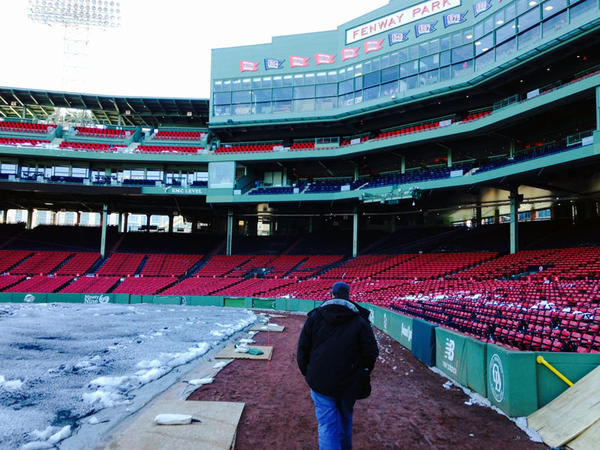 Fenway Park Director of Grounds David Mellor walks near the third-base line.