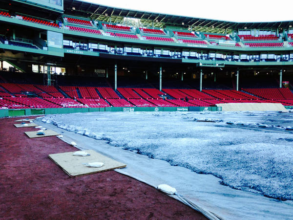 A blanket, and a bit of snow, covers the Fenway field.