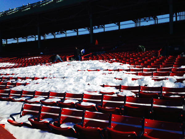 Snow fills the stands at Fenway.