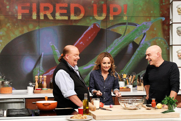 Celebrity chef Giada De Laurentiis during a guest appearance on ABC's <em>The Chew </em>last fall. She can cook rich foods and keep her trim figure, but new research suggests that's a difficult feat for amateur cooks watching along at home.