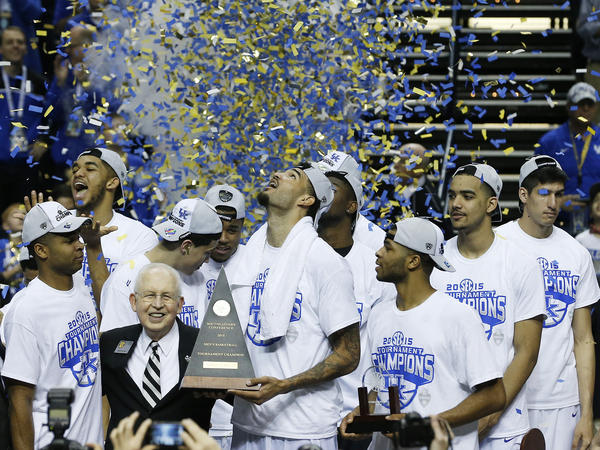 University of Kentucky basketball players celebrate their Southeastern Conference tournament championship victory earlier this month.