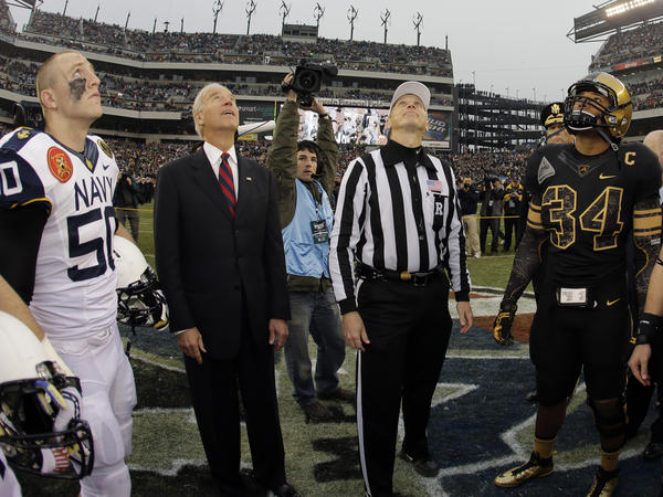 Vice President Biden waits for the coin to drop at an NCAA football game. Presumably, he will not flip a coin if he has to break a Senate tie to confirm Loretta Lynch as attorney general.
