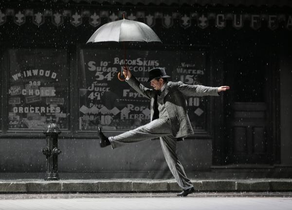 An actor performs during a March 9 rehearsal of <em>Singin' in the Rain</em> on the stage of the Theatre du Chatelet in Paris. American musicals were rarely performed in France in the past, but have been a huge hit in recent years.