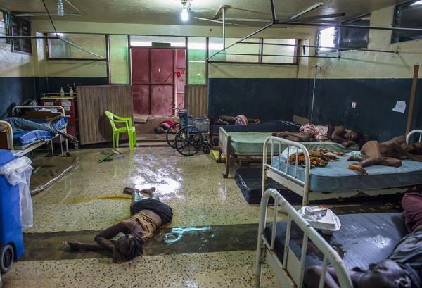 Two people lie dead on the floor inside the critical ward of the Redemption Hospital, which served as a transfer and holding center for Ebola patients.