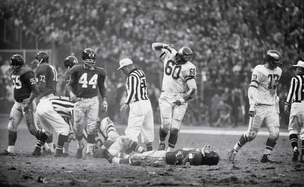 Philadelphia Eagles Chuck Bednarik (60) is victorious in an iconic 1960 photograph after making a sack vs. New York Giants Frank Gifford (16). Bednarik died on Saturday. He was 89.