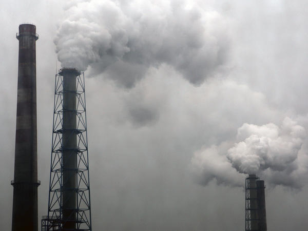 Smoke billows from chimneys of a steel plant on a hazy day in Hangzhou, Zhejiang province, earlier this month.
