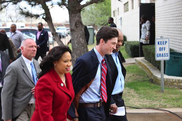Levi Pettit, center, walks into the Fairview Missionary Baptist Church in Oklahoma City with state senator Anastasia Pittman and pastor J.A. Reed, Jr.