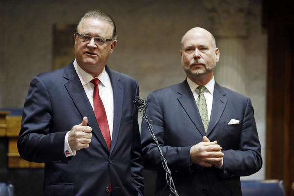 Indiana Senate President Pro Tem David Long (left) and House Speaker Brian C. Bosma, both Republicans, discuss their plans for clarifying the Indiana Religious Freedom Restoration Act during a news conference today at the Statehouse in Indianapolis.