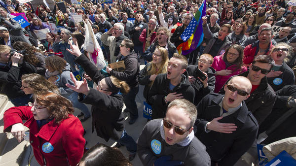 Opponents of Indiana's Religious Freedom Restoration Act gathered in front of the Indiana State House Saturday.