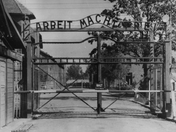 "The Nazi concentration camp Auschwitz I in Poland, circa 1945. Writing over the gate reads <em>""Arbeit macht frei""</em> (Work Sets You Free). Johann Breyer has admitted to working as a guard at the camp but says he only supervised work parties outside the gates."