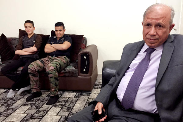 Al-Shargat Mayor Ali Dodah Khalaf Jabouri sits with Hani Abdul Karem Jabouri and Sabri Ahmed Jabouri. Each lost family members who were killed by Islamic State fighters, and all are now working with Iran-backed Shiite groups to retake their city.