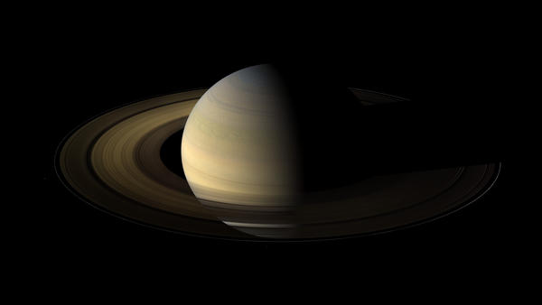 Saturn has a rocky surface, but it's deep beneath the clouds. That makes it hard to tell exactly how long the day is.
