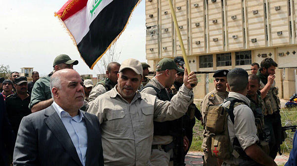 Iraqi Prime Minister Haider al-Abadi (left) tours Tikrit after it was retaken by security forces Wednesday, a key step in driving the militants out of their biggest strongholds.