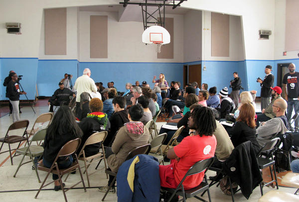 "Activists gather at a school next door to the Greater St. Mark Family Church in Ferguson, Mo., for a meeting of what the Organization for Black Struggle was calling a ""People's Movement Assembly."""