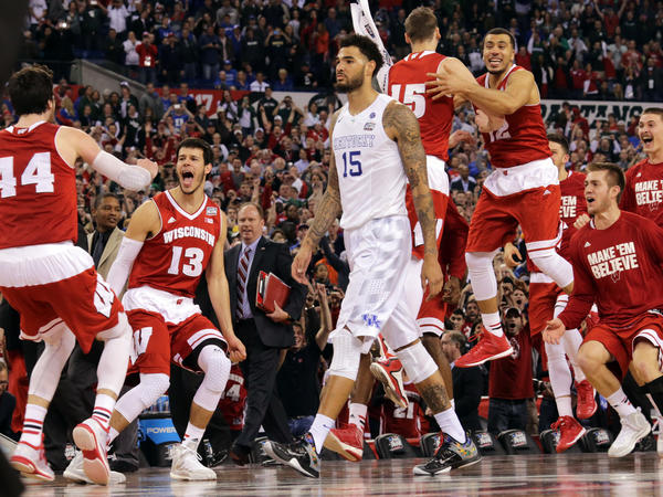 The Wisconsin bench celebrates as Kentucky's Willie Cauley-Stein walks off after the NCAA Final Four game Saturday. Wisconsin won 71-64.