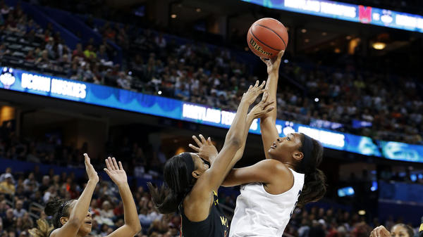 Morgan Tuck of the Connecticut Huskies shoots against Shatori Walker-Kimbrough of the Maryland Terrapins during the NCAA women's Final Four in Tampa, Fla.