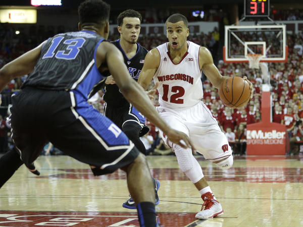 Traevon Jackson of the Wisconsin Badgers drives to the hoop during a game against the Duke Blue Devils on December 03, 2014. They will face one another again in the NCAA championship game Monday.