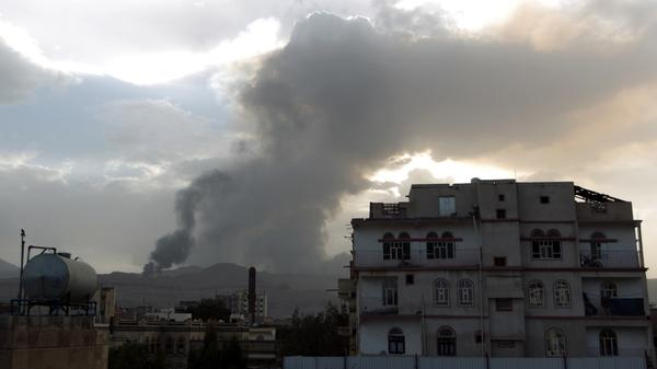 Smoke and flames reportedly from Shiite Houthi rebels camps rise over part of the Yemeni capital, Sanaa, on Monday. Fierce fighting has left people trapped, including U.S. citizens.