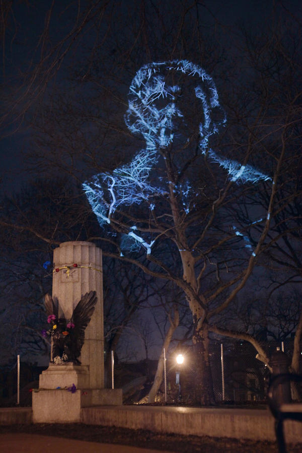 The Illuminator Art Collective used ashes and light to project the image of Snowden.